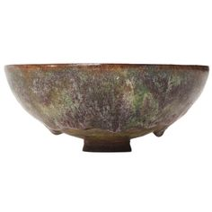 Exceptional Ceramic Bowl By Gertrude and Otto Natzler | A fine and rare ceramic footed vessel having exceptionally thin walls, perfectly round form and a rich experimental volcanic glaze.