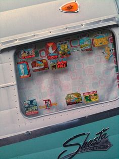 Shasta trailer window - I love the window stickers...when I was a kid, my side of my mom's station wagon was always covered from where we had been...I loved it...
