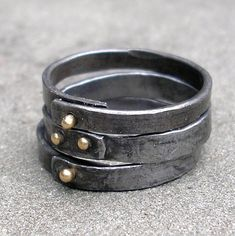 Gold Steel Rings - Forged Steel Stacking Rings - 18 KT Gold Steel Rings - Riveted Steel Rings - Blacksmith Jewelry - Riveted Stacking Rings Stacking rings of forged steel and 18 KT yellow gold rivets. This price is for 3 rings. Each ring starts with round steel rod that is hand forged flat