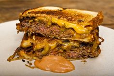 classic beef patty melts w/ gooey american cheese, toasted white sandwich bread, caramelized onions & thousand island dip