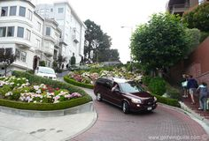 The best way to visit Lombard Street is by cable car that will drop you off at the top of Lombard Street. A walk down the street with its sharp switchbacks is an experience that offers rewards, as you reach the bottom and look up towards the top of Lombard Street, to get a real appreciation of its steepness and extreme curves. The bottom of Lombard Street is popular with photographers looking to capture the ultimate shot of the crooked, hilly street.