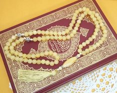 Islamic prayer beads that make great gifts for Ramadan! This 99 bead butter yellow Honey Calcite Muslim tasbih solves your gift giving problem! Click to visit my Etsy shop for dozens more styles! Islamic Prayer, Islamic Gifts, Unique Gifts, Great Gifts, Handmade Gifts, Honey Calcite, Ramadan Gifts, Prayer Beads, Animals For Kids