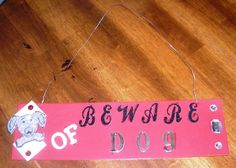 Beware of Dog Sign - Hubby didn't think it was vicious enough for the fence... LOL  It hangs in my craft room!  :)