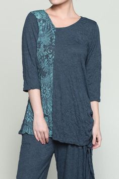 This crinkle burnout top is designed to be as breezy and refined as the woman wearing it. Variations in fabric and trim contribute to the one-of-a-kind look of this piece created by Chalet et ceci. Light and airy 3/4 sleeve top with ruched drawstring design on one side making it flexible and fun. This fabric packs well making it a great travel piece. Machine wash. Made in the USA.   Cristabel Top by Chalet et ceci. Clothing - Tops - Tunics California