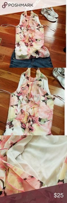 BCX Floral Print Halter Tie Top Excellent condition still a lot of miles left the next Posher to rock this top! Zip side and halter tie straps to finish the look as you like! BCX Tops Blouses