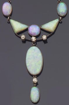 Circa 1890 opal and diamond pendant necklace, composed of a graduated row of oval opal cabochons each within a closed back setting, set to the center with two triangular-shaped opals suspending a knifewire swag with three old brilliant-cut diamond highlights and opal swing drop below, length 39.0cm.