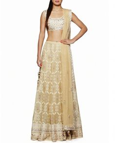 Beige lengha with woven texture and gota patti work. Embroidered and embellished hemline. This set comes with a matching ivory sleeveless blouse featuring embroidery and gota patti work. Scoop neck. Wash Care: Dry clean onlyMatching embellished dupatta includedClosure: Zip at side