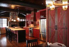 LOVE LOVE LOVE this kitchen!!! Look at all the red! The barn doors! The island! :) - Land's End Development