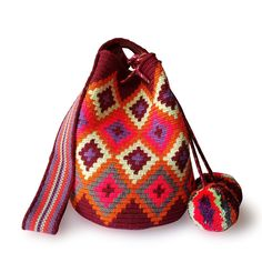 $49.90-$52.90 #Wayuubags. These double thread small mochila bag are perfect for carrying around a few items such as your phone, wallet and a few other necessities. They also make a very cute gift for younger women and young girls. The colors of these mochilas Wayuu are inspired by the vivid colors that surround region of La Guajira. All Wayuu bags come with a handwritten postcard, and little gift. The time required to elaborate a Wayuu Mochila varies from 4-7 days.  www.lombiaandco.com Tapestry Bag, Tapestry Crochet, Gifts For Young Women, Magic Bag, Crochet Baby Booties, Phone Wallet, Filet Crochet, Crochet Accessories, Little Gifts