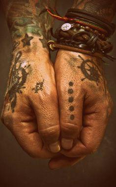 ...These hands werent even identified on Pintrest.  NIKKI SIXX!