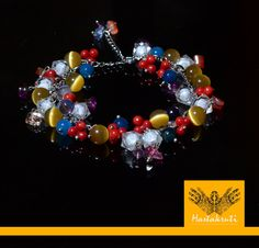 This is a bright colorful cha cha bracelet which has various color glass bead with faux silver chain and an adjustable clasp.