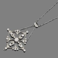 A diamond pendant necklace, circa 1900 The finely pierced navette-shaped plaque of floral design, millegrain-set throughout with old brilliant and single-cut diamonds, to a similarly-cut diamond surmount and a figaro-link chain