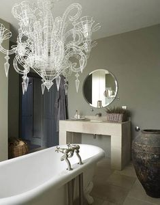 Love the wall colour, basic Ikea mirror and the amazing chandelier (just like the one at Maple Homewares).