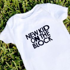 Learn how to create this New Kids On The Block inspired onesie with heat transfer vinyl. Free cut file included.