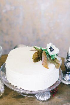 anemone-topped cake, photo by Natasha Hurley http://ruffledblog.com/winter-whites-wedding-inspiration #weddingcake