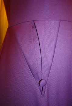 Beautiful pleated pocket detailThe Facts Fabric: Purple wool from Stone Mountain & Daughter Pattern: Decades of Style 5007 Notions: Interfacing, zipper, 2 buttons, all from stash Year: 1950′s inspired Time to complete: 4 hours First worn: December 2012 Wear again? Maybe, if and when I fix it