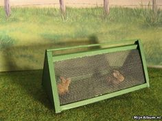 Miniature Rabbit hutch tutorial. In Dutch, but the photos are easy to follow and you can always use Google Translate. Be sure to click on the links on the left hand for lots of other tutorials.