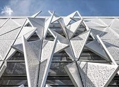 Henning Larsen Architects' design for the Syddansk Universitet communications and design building in Kolding, Denmark, features a climate-responsive kinetic facade that regulates interior temperatures. The completed building is the first to meet Danish 2015 building code energy targets, according to the architects, and it gets serious points for aesthetics too.