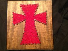 String art cross by StringMeToTheMoon on Etsy, $30.00