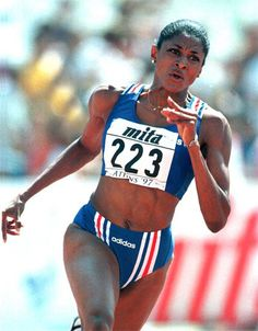 Marie-José Pérec competing in the early rounds of the 200 metres event at the 1997 IAAF World Athletics Championships, held in Athens. The 1996 Olympic Champion in the event, Pérec qualified seventh fastest for the semi finals, but had to withdraw due to injury.