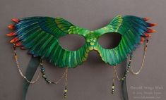 A mask commission for my Dusk Raven wings, but in green tones. This mask features glass and stone beads, including peridot. Hand carved and shaped. Emerald Wings Leather Mask with Beads Masquerade Costumes, Masquerade Party, Raven Wings, Feather Mask, Bird Masks, Paper Mask, Cool Masks, Animal Masks, Venetian Masks