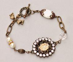 Vintage Assemblage Charm BraceletBlush by hangingbyathread1