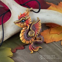 I absolutely love autumn. At the time this is posted, it's the dead heat of summer at the Workshop, and this fall coloured dragon pendant gets me wistful for one of my favourite seasons of the year (right next to winter)!