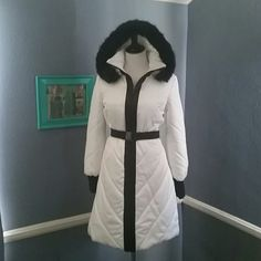 NWOT White satin puffer car coat This stunner just jumped out of the back of my closet. Satin in & out including blk trim. Slash pockets zip closed. There is a faint 1 inch watermark (?) On the right sleeve but it's so light no pic showed it. Blk faux fur hood.  Tag is missing but a bebe find. Bonus..the hood isn't sized for toddlers!! Jackets & Coats Puffers