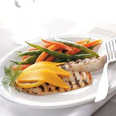 "Grilled Tilapia with Mango Recipe from Taste of Home-""This is a different twist on tilapia that I created for my wife. She enjoyed the combination of mango with the Parmesan. There's nothing like eating this out on the deck with a cold glass of iced tea."" Gregg May - Columbus, OH"