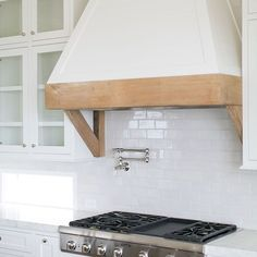 White French Kitchen Hood with Rustic Wood Trim and Brackets - Transitional - Kitchen Kitchen Redo, New Kitchen, Kitchen Remodel, French Kitchen, Modern Farmhouse Kitchens, Home Kitchens, Range Hood Cover, Kitchen Vent Hood, Wood Hood Vent
