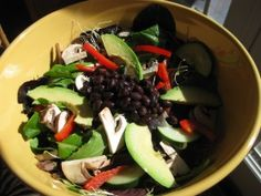 Baby romaine, black beans, avocado, corn, tomato, and red bell pepper