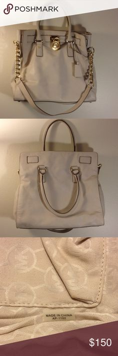 """Michael Kors extra large leather tote purse Beautiful authentic MK purse in good clean condition. Carried a few times, snap top closure, gold tone signed hardware, comes with attached shoulder strap, clean signature lining 12.5"""" tall 17"""" across, 12"""" strap drop Michael Kors Bags Totes"""
