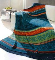 Vivid blues, greens and oranges set off the boho pattern of this Bocasa Oleana throw. Overstock.com