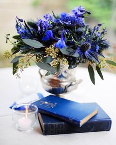 An eclectic mix of blue flowers is housed in assorted trophy cups found at antiques shops.