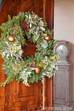 Nothing welcomes holiday visitors quite like a gorgeous wreath on the front door. Here, pinecones, flowers, and leaves weave in some texture, while gold pears add glam.
