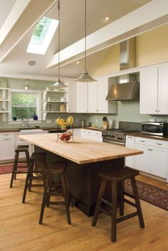 square free standing kitchen island seating with round chandelier