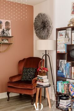 This Manhattan home office is warm, inviting, and filled with things that people actually don't mind starring at via zoom. #homeoffice #office #chair #books #bookshelf #lamp #flowers #wallpaint Vintage Apartment, Colorful Apartment, Living Room Orange, Manhattan Apartment, Cozy Nook, Room Colors, Paint Colors, Architectural Digest, Cool Walls