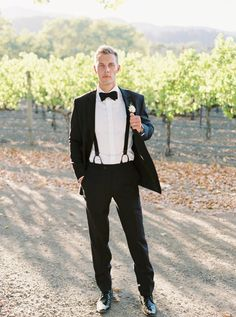Groom in a classic black tux: http://www.stylemepretty.com/2016/12/28/this-is-why-getting-married-in-napa-is-wedding-goals-to-the-max/ Photography: Jessica Burke - http://www.jessicaburke.com/