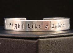 Fight Like a Zebra EDS Awareness Cuff in Aluminum via Etsy