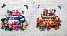 Cross stitch tea cups on a towel