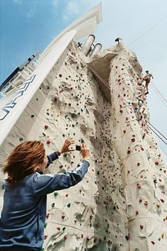 Independence of the Seas | Take on the rock climbing wall on Independence of the Seas. Climb 40 feet above deck and take in a 180º panorama of the ocean before belaying down to challenge the Flowrider and basketball court.