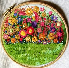 """This is """"A Riot in the Garden"""" by dozydotes. The colours are fabulous and shows what you can do by playing with embroidery.  Image courtesy of https://www.flickr.com/photos/35808964@N06/4455579537/in/pool-1693930@N20/"""