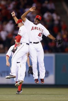 Mike Trout (L) #27 and Torii Hunter #48 of the Los Angeles Angels of Anaheim celebrate their teams 3-0 victory over the Baltimore Orioles at Angel Stadium of Anaheim on July 7, 2012 in Anaheim, California. (Photo by Jeff Gross/Getty Images)