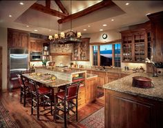 love this log cabin kitchen!