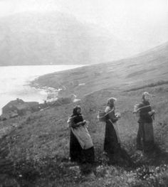 Women knitting while walking; a standard practice at the time