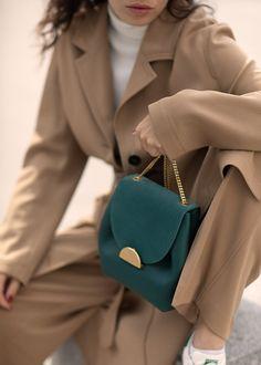 "Undeniably feminine for its sensual curves, ""Number One Mini"" is Polène's signature handbag. Designed as a day bag, you'll love its elegant yet easy-going style. Luxury Bags, Luxury Handbags, Polene Paris, Suitcase Bag, Metallic Bag, Cute Purses, Day Bag, Minimal Chic, Green Bag"