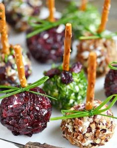 Cranberry goat cheese bites. Get this and more of the best holiday small bites and appetizer recipes guests will love. #cranberry #goatchesse #smallbites #holidayrecipes #holidayparty #partyfood #appetizers