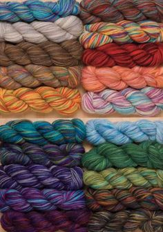 Imagination Hand Painted Sock Yarn 2 ply Fingering weight $6.79 219 yds 50% Merino Wool 25% Superfine Alpaca, 25% Nylon.  This provides the luxury and warmth of a superfine alpaca with the squishy softness of Merino wool.  Each hand-painted hank has at least 5 colors.