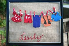 NEW!  Looks like laundry day at Mickey Mouse Clubhouse!  Laundry art with Disney inspired clothes hanging on the line.  Just $9.00 (Frame not included)