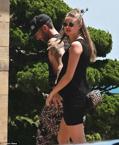 Celebrating second wedding anniversary July 19! Adam Levine escorted his pregnant wife Behati Prinsloo - who will welcome their daughter in September - to lunch at Nobu Malibu on Saturday